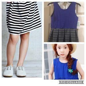 Little girl's sleeveless blue and black dress.